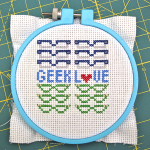 Pattern: Geek Love Cross-Stitch Pattern and Geek Crafts Column on FaveCrafts | Red-Handled Scissors